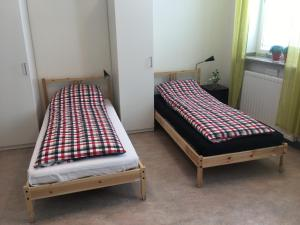 A bed or beds in a room at Hostel Finnmyrten