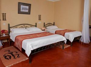 Een bed of bedden in een kamer bij Ashnil Aruba Lodge