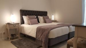 Cama o camas de una habitación en Grande Pensao Residencial Alcobia