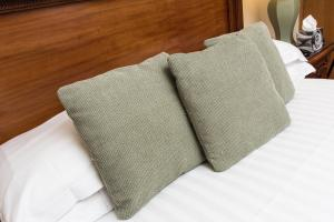 A bed or beds in a room at The Castle Inn Hotel by BW Signature Collection, Keswick