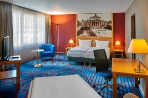 A bed or beds in a room at Mercure Hotel Berlin Tempelhof