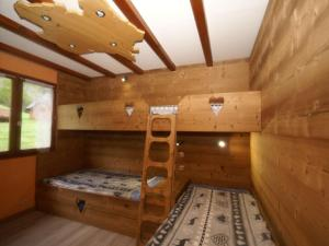 A bunk bed or bunk beds in a room at Cozy Hill View Chalet in Ventron near Ski Lift