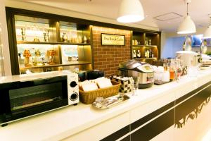 A restaurant or other place to eat at Spa & Capsule Hotel GrandPark-Inn Sugamo