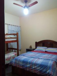 A bed or beds in a room at Casa em Cabo Frio