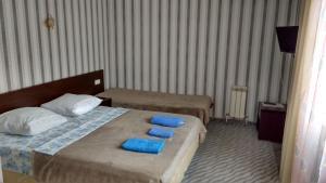 Кровать или кровати в номере Гостевой дом «Амелия»