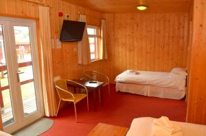 A bed or beds in a room at Spean Bridge Hotel
