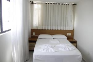 A bed or beds in a room at Portugal Flat