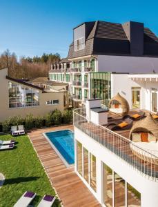 The swimming pool at or near LIFESTYLE Resort Zum Kurfürsten