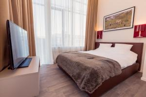 A bed or beds in a room at Brera Serviced Apartments Munich