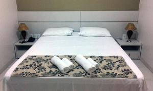 Cama ou camas em um quarto em Esplanada Hotel