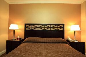 Cama ou camas em um quarto em Radio City Apartments
