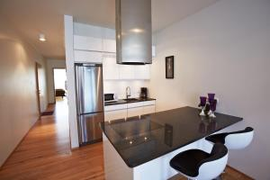 A kitchen or kitchenette at Reykjavik4You Apartments