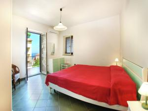 A bed or beds in a room at Comfortable Apartment in Sardinia with Swimming Pool