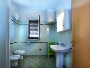 A bathroom at Comfortable Apartment in Sardinia with Swimming Pool
