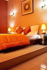 Un ou plusieurs lits dans un hébergement de l'établissement La Villa Serere
