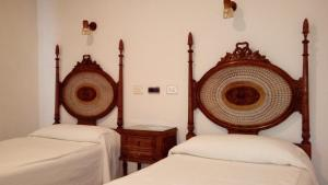 A bed or beds in a room at Hotel Los Perales