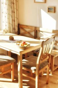 Ein Restaurant oder anderes Speiselokal in der Unterkunft Wolf-Hof