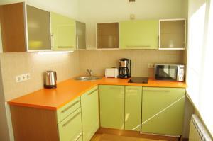 A kitchen or kitchenette at Klara Apartment