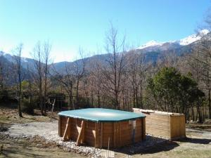 Chalet de Caralba avec piscine during the winter