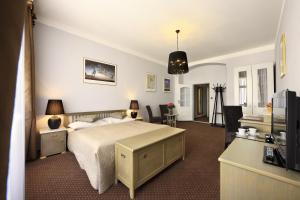 Ein Bett oder Betten in einem Zimmer der Unterkunft Hotel Salvator