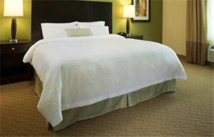 A bed or beds in a room at Hampton Inn Augusta