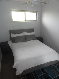A bed or beds in a room at Prime location & spacious