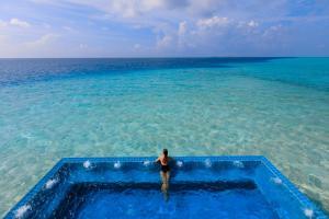 The swimming pool at or near Velassaru Maldives
