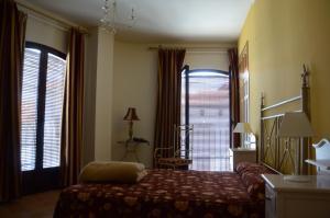 Cama o camas de una habitación en Hotel Rural Casas de Don Adame