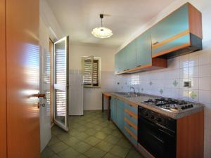 A kitchen or kitchenette at Modern Apartment in Sardinia with shared Pool