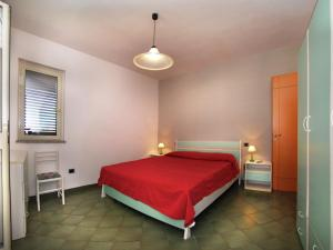 A bed or beds in a room at Modern Apartment in Sardinia with shared Pool