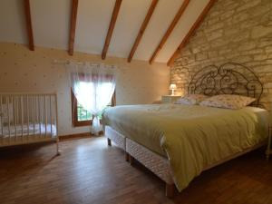 A bed or beds in a room at Cozy Holiday Home in Argancon with Terrace