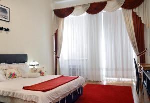 Łóżko lub łóżka w pokoju w obiekcie Pokoje Gościnne Vera