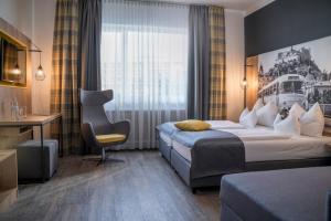 A bed or beds in a room at K6 Rooms by Der Salzburger Hof