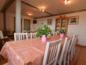 A restaurant or other place to eat at Stylish Apartment in Heppenbach with Terrace