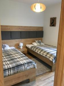 Łóżko lub łóżka w pokoju w obiekcie Apartament Perla Zakopane