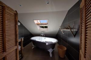 A bathroom at Hotel Du Grand Cerf & Spa