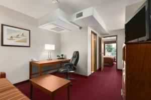 A television and/or entertainment center at Super 8 by Wyndham Yellowknife