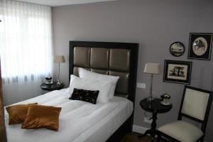 Ein Bett oder Betten in einem Zimmer der Unterkunft Gasthof Engel