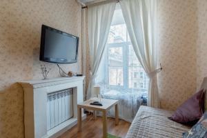 Телевизор и/или развлекательный центр в Апартаменты на Невском проспекте 88
