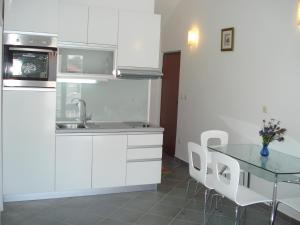 A kitchen or kitchenette at Apartments Sea Star