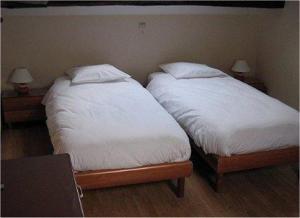 Un ou plusieurs lits dans un hébergement de l'établissement Chambre Tourisme