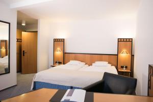 Кровать или кровати в номере Hotel Schere