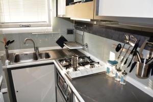 Cucina o angolo cottura di Design Apartment in Rome