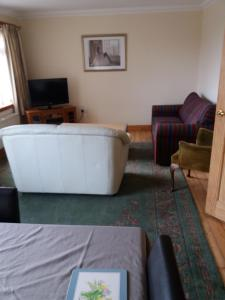 A television and/or entertainment center at House for Groups & Contractors Kilmarnock