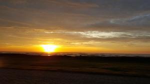 O pôr ou nascer do sol visto da pousada ou dos arredores