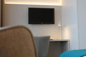 A television and/or entertainment center at WestCord Hotel Noordsee