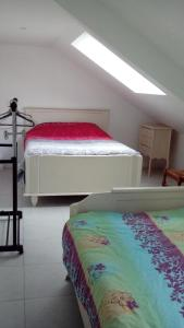 A bed or beds in a room at Gîte de Blessy