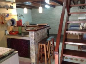 A kitchen or kitchenette at Angel Ilha Flats