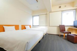 A bed or beds in a room at FLEXSTAY INN Sugamo