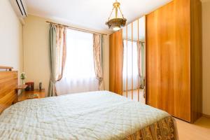 Кровать или кровати в номере Stylish Europa near Moscow City